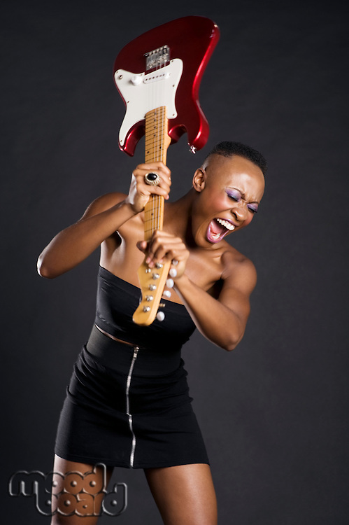 African American woman about to break guitar