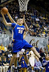 December 29, 2009; Berkeley, CA, USA;  UC Santa Barbara Gauchos center Greg Somogyi (55) grabs a rebound from California Golden Bears center Max Zhang (14) during the second half at Haas Pavilion.  California defeated UC Santa Barbara 87-66.