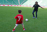 (R) Christian Karembeu - Special Olympics Ambassador  former French soccer player and current scout for Arsenal Football Club and (L) Kuba Zewlakow (son of Michal) plays soccer before final match between SO Serbia (red) and SO Romania (white) during the 2013 Special Olympics European Unified Football Tournament in Warsaw, Poland.<br /> <br /> Poland, Warsaw, June 08, 2012<br /> <br /> Picture also available in RAW (NEF) or TIFF format on special request.<br /> <br /> For editorial use only. Any commercial or promotional use requires permission.<br /> <br /> <br /> Mandatory credit:<br /> Photo by © Adam Nurkiewicz / Mediasport