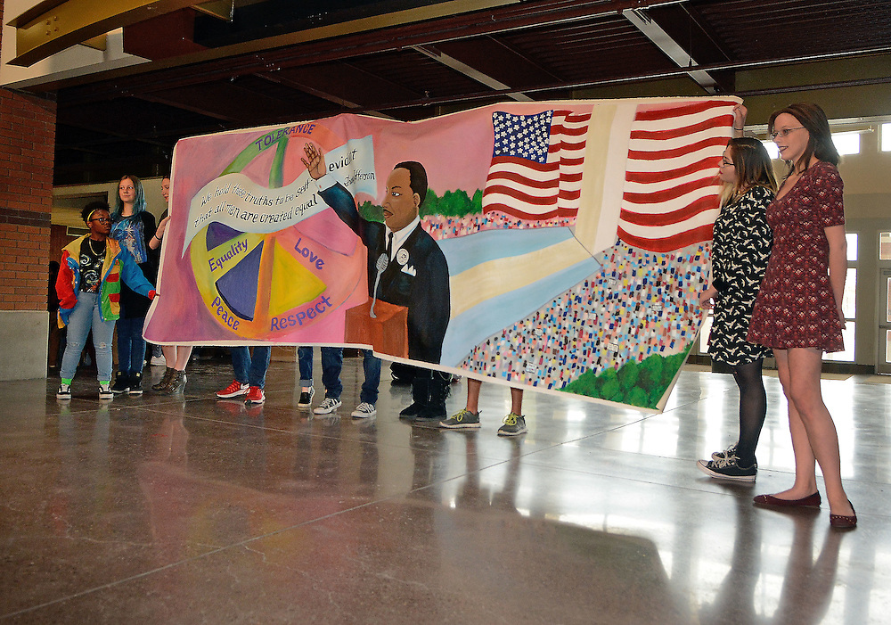 jt011317a/a sec/jim thompson/ Left to right- Cibola High School artist Chloe Baker, Jaydon Byington, Sierra Pascarella Adrienne Sena and Jazmarie Wisor stand by the mural that they painted. The design was by Wisor and it depicts the legacy and mission of Dr. Martin Luther King Jr.  and is march on Washington D.C.Friday Jan. 13, 2017. (Jim Thompson/Albuquerque Journal)