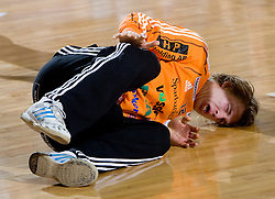 Injured goalkeeper of Ystads Leo Larson during the 1/ 8 Men's European Handball Challenge Cup match between RD Slovan, Slovenia and Ystads IF, Sweden, on February 21, 2009 in Arena Kodeljevo, Ljubljana, Slovenia. Slovan defeated Ystads 37-27 and qualified to quarterfinals. (Photo by Vid Ponikvar / Sportida)