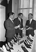 01/04/1963<br /> 04/01/1963<br /> 01 April 1963<br /> Edenderry Shoe Co. reception at Russell Hotel, Dublin. Picture shows (l-r): Mr. T. Walsh, (Southern Rep.); Mr. Peter Watchman, Director and Mr. B. Noble, (Dublin and Northern Rep.).