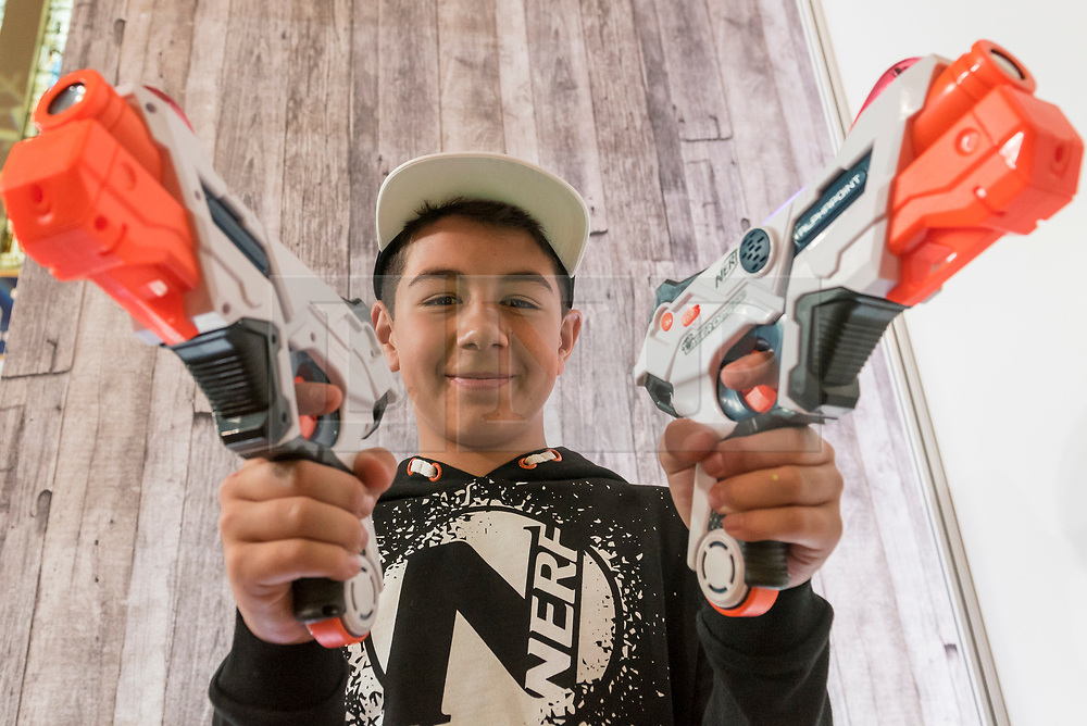 """© Licensed to London News Pictures. 14/11/2018. LONDON, UK. Ashton, aged 12, plays with Lazer X Twin Pack by Character Options. Preview of """"DreamToys"""", the official toys and games Christmas Preview, held at St Mary's church in Marylebone.  Recognised as the countdown to Christmas, the Toy Retailer's Association, an independent panel of leading UK toy retailers, have selected the definitive and most authoritative list of what toys will be the hottest property this Christmas. [Child models provided by show organisers, permission obtained to be photographed].  Photo credit: Stephen Chung/LNP"""