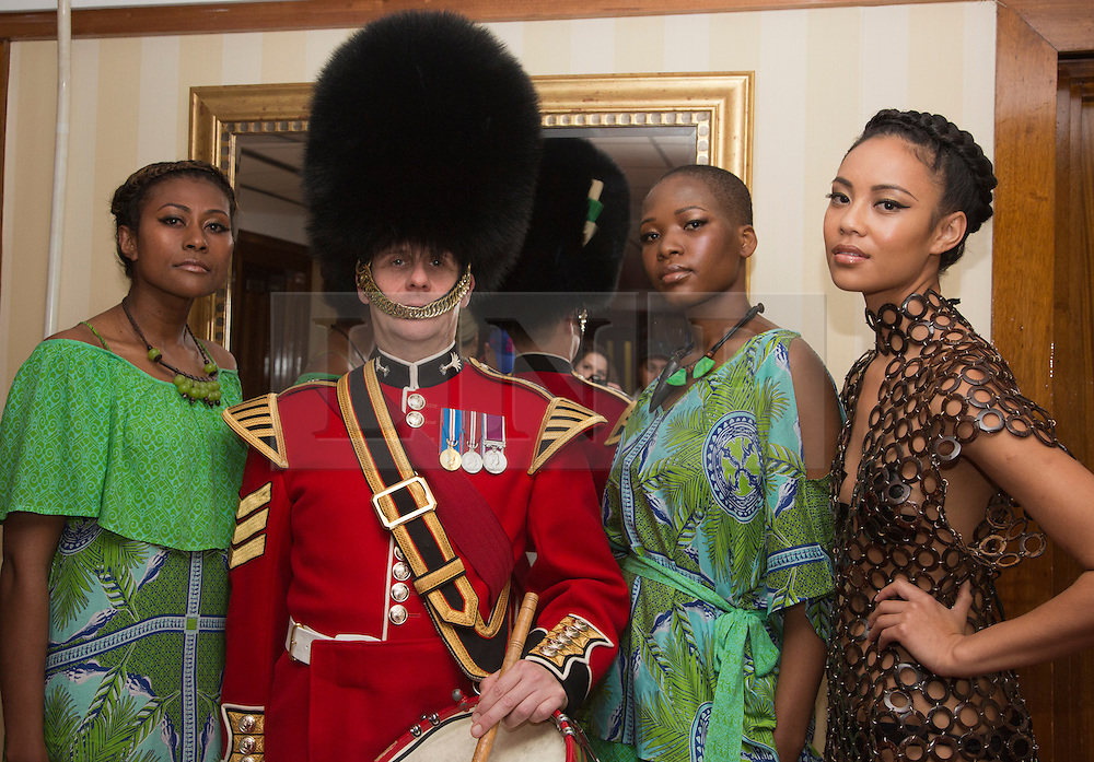 © Licensed to London News Pictures. 03/10/2012. London, England. Models showcasing fashion with a guardman. Press launch for Friday's London Pacific Fashion Show at the Salvation Army Theatre in Oxford Street. The fashion show on Friday will feature 13 designers from New Zealand and the South Pacific region with 60 models and 4 dance groups. The show is in support of the Help for Heroes charity. Help for Heroes provides direct, practical support to wounded, injured and sick Service personnel, veterans, and their families. Photo credit: Bettina Strenske/LNP