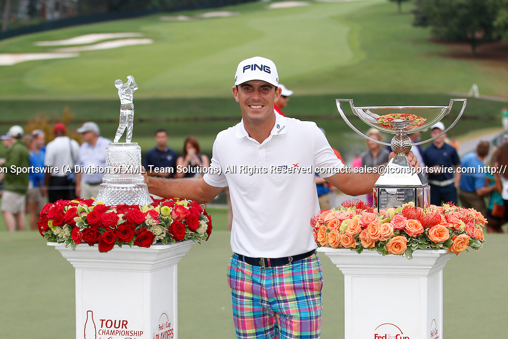 September 14, 2014:  Billy Horschel stands with both trophies after winning the FedEx Cup - The Tour Championship at East Lake Golf Club in Atlanta, Georgia.