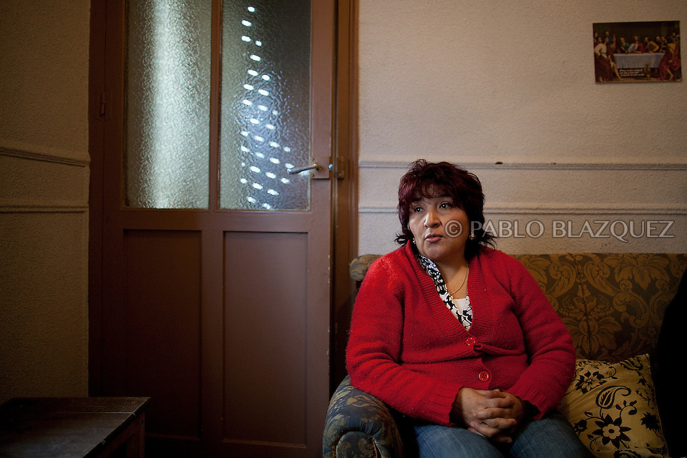 Olga Teresa Cabrera Maza waits for her eviction on February 22, 2012. Cabrera Maza, a 48-year-old immigrant form Ecuador, lives with her daughter in Madrid and started paying her mortgage on 2006 but then underwent serious health problems that let her in a permanent incapacity. Unable to work and earning a monthly pension of 600€ for her incapacity, she could not afford to pay her mortgage, which had increased from 800€ to 1890€ and stopped paying it on June 2010. She was served her first eviction notice in June 2011. The Organization Anti-evictions supported her and she finally got permission to stay at her appartment for another month. She is claiming a lieu of payment to the bank, so she can go back to her country without a debit of 250.000€, where her family will take care of her and her illness.