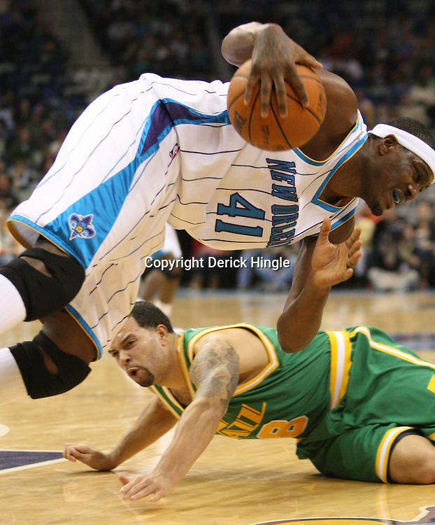 Feb 17, 2010; New Orleans, LA, USA; New Orleans Hornets forward James Posey (41) and Utah Jazz guard Deron Williams (8) scramble for a loose ball during the second quarter at the New Orleans Arena. Mandatory Credit: Derick E. Hingle-US PRESSWIRE