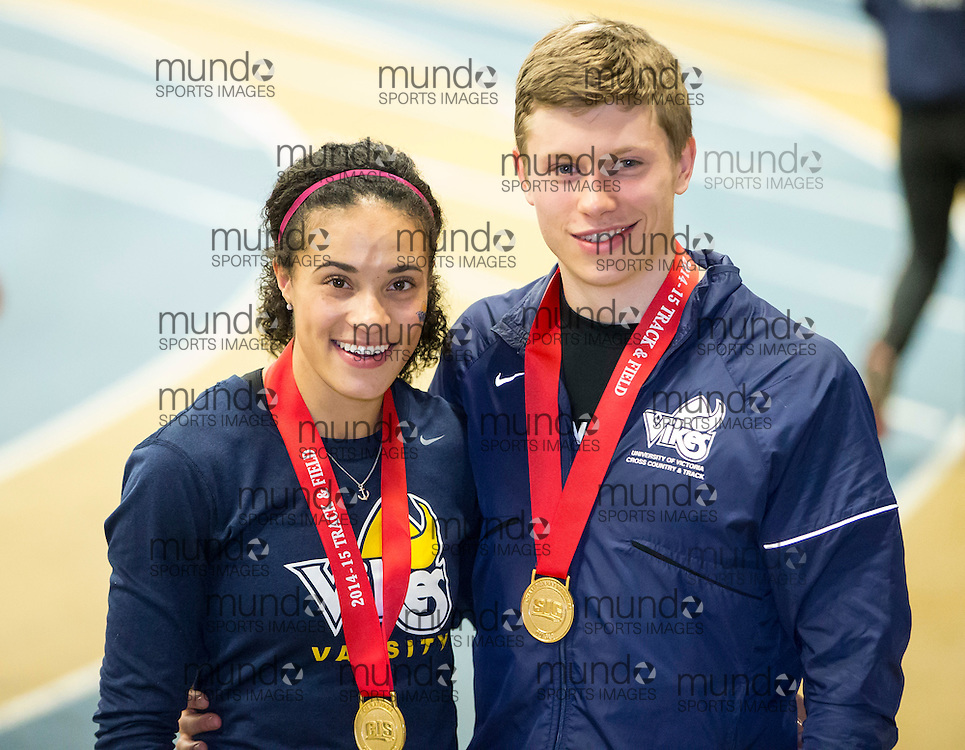 Windsor, Ontario ---2015-03-14--- 600 meter Gold medalists Adam Paul-Morris and  Rachel Francois of the University of Victoria pose with their medals at the 2015 CIS Track and Field Championships in Windsor, Ontario, March 14, 2015.<br /> GEOFF ROBINS/ Mundo Sport Images