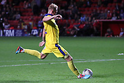 AFC Wimbledon midfielder Mitchell (Mitch) Pinnock (11) scoring penalty during the EFL Trophy match between Charlton Athletic and AFC Wimbledon at The Valley, London, England on 4 September 2018.