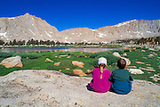 Kids enjoying the view in the Cottonwood Lakes Basin, John Muir Wilderness, Sierra Nevada Mountains, California USA