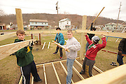 Students from the Kent Campus build a playhouse at a park in East Liverpool East Liverpool as part of an alternative spring break, in which students spend a week performing community service.