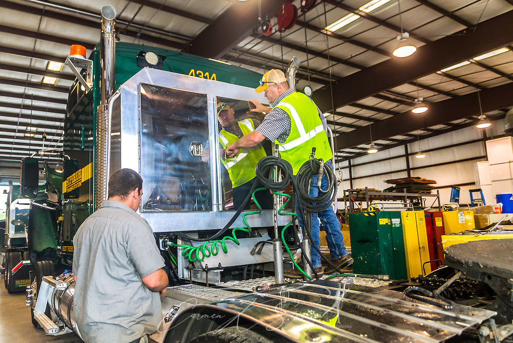 Technicians perform routine maintenance on a Mack Pinnacle truck sits in the mechanic shop for routine maintenance at Superior Transportation, Oct. 2, 2015, in North Charleston, South Carolina. (Photo by Carmen K. Sisson/Cloudybright)