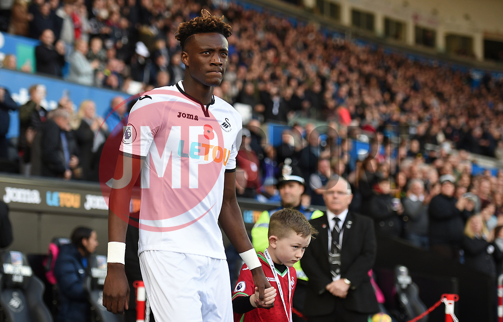 Tammy Abraham of Swansea City walks onto the pitch with his mascot  - Mandatory by-line: Alex James/JMP - 04/11/2017 - FOOTBALL - Liberty Stadium - Swansea, England - Swansea City v Brighton and Hove Albion - Premier League