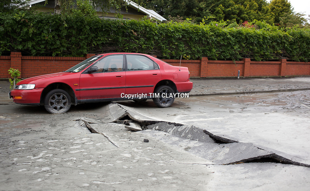 Road damage after a Powerful earth quack ripped through Christchurch, New Zealand on Tuesday lunch time killing at least 65 people as it brought down buildings, buckled roads and damaged churches and the Cities Cathedral. Photo Tim Clayton