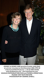 JOHNNY & WENDY KIDD parents of model Jodie Kidd, at a dinner in London on 2nd December 2003.PPE 26