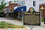 Historical marker sign on town square details history of Monroeville, Alabama.