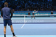 Novak Djokovic with a return back hand in the warm up during the final of the ATP World Tour Finals between Roger Federer of Switzerland and Novak Djokovic at the O2 Arena, London, United Kingdom on 22 November 2015. Photo by Phil Duncan.