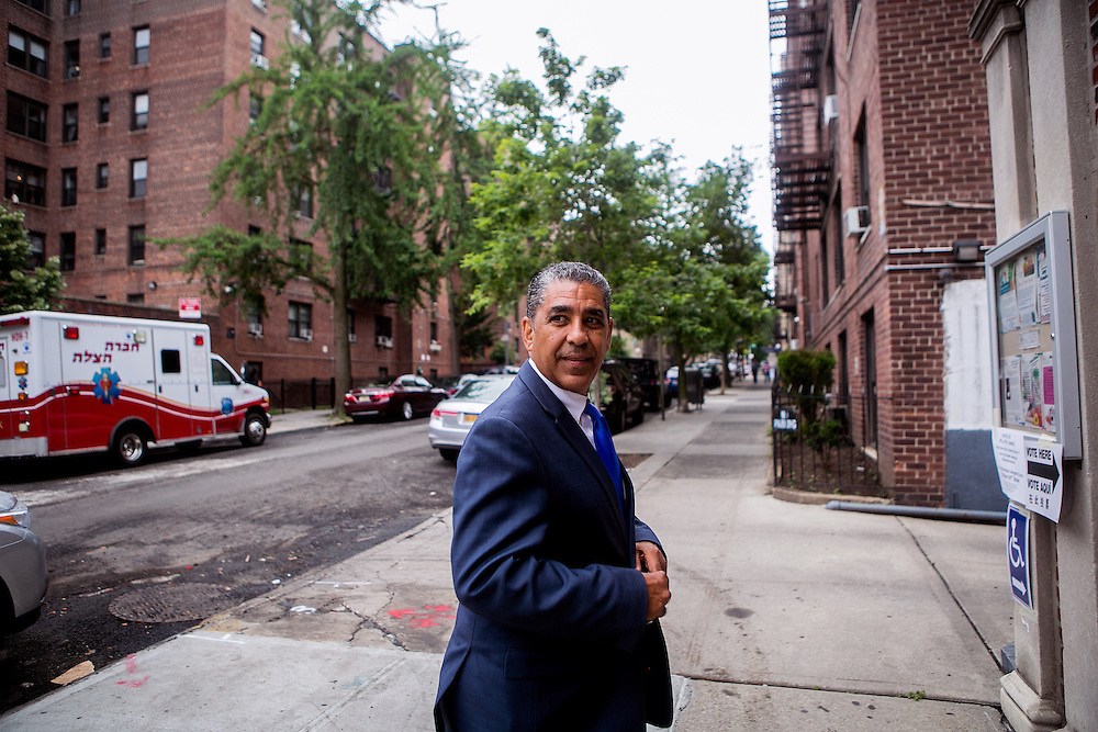 NEW YORK, NY - JUNE 28, 2016: Congressional candidate and New York State Senator Adriano Espaillat greets residents at A.R.C. at 4111 Broadway in New York, New York. CREDIT: Sam Hodgson for The New York Times.
