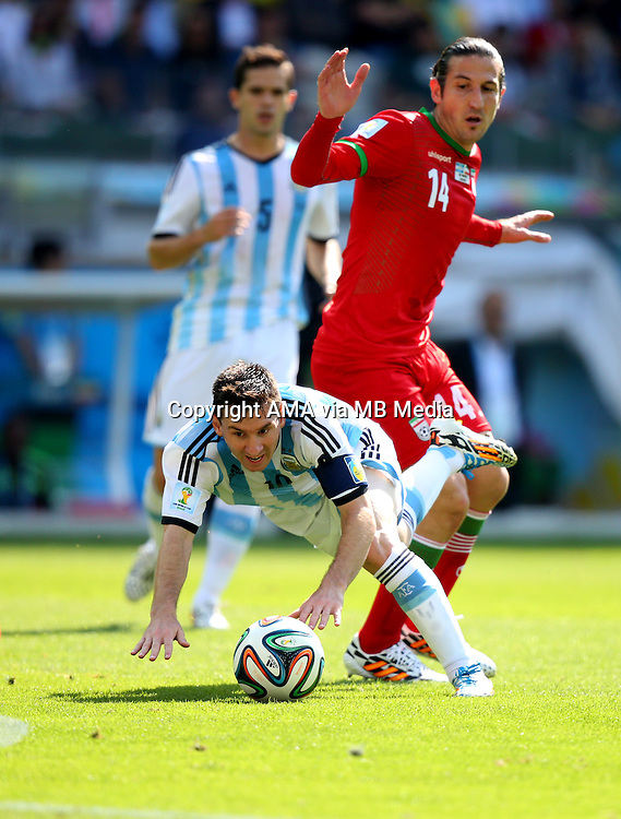 Lionel Messi of Argentina and Andranik Teymourian of Iran