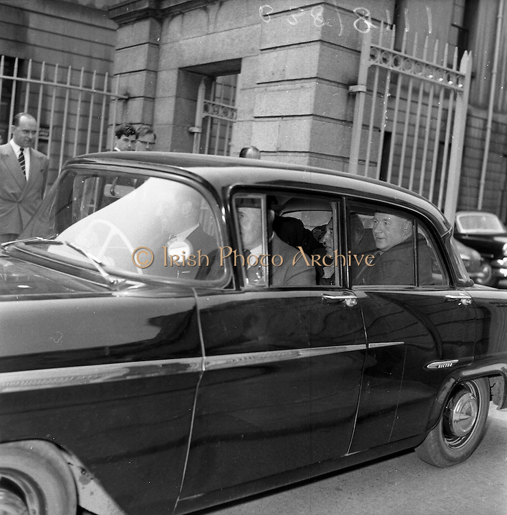 14/05/1959<br /> 05/14/1959<br /> 14 May 1959<br /> Mr. Hully leaving the High Court to attend at District Court.<br /> Vauxhall Victor car