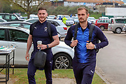 AFC Wimbledon striker James Hanson (18) and AFC Wimbledon goalkeeper Joe McDonnell (24) arriving during the EFL Sky Bet League 1 match between AFC Wimbledon and Accrington Stanley at the Cherry Red Records Stadium, Kingston, England on 6 April 2019.