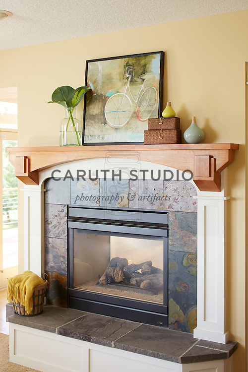 How to Style a Mantel: Styled mantel on double-sided fireplace