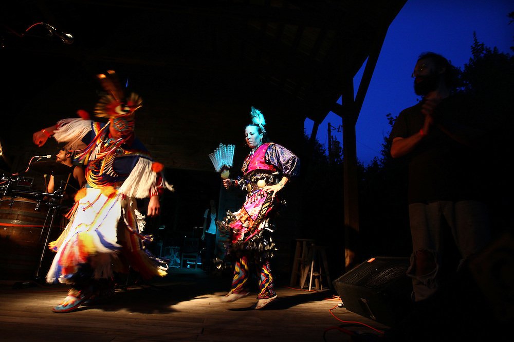 Native American dancers perform with Psalters, a band from Philadelphia, on the main stage at the Wild Goose Festival at Shakori Hills in North Carolina June 23, 2011.  (Photo by Courtney Perry)