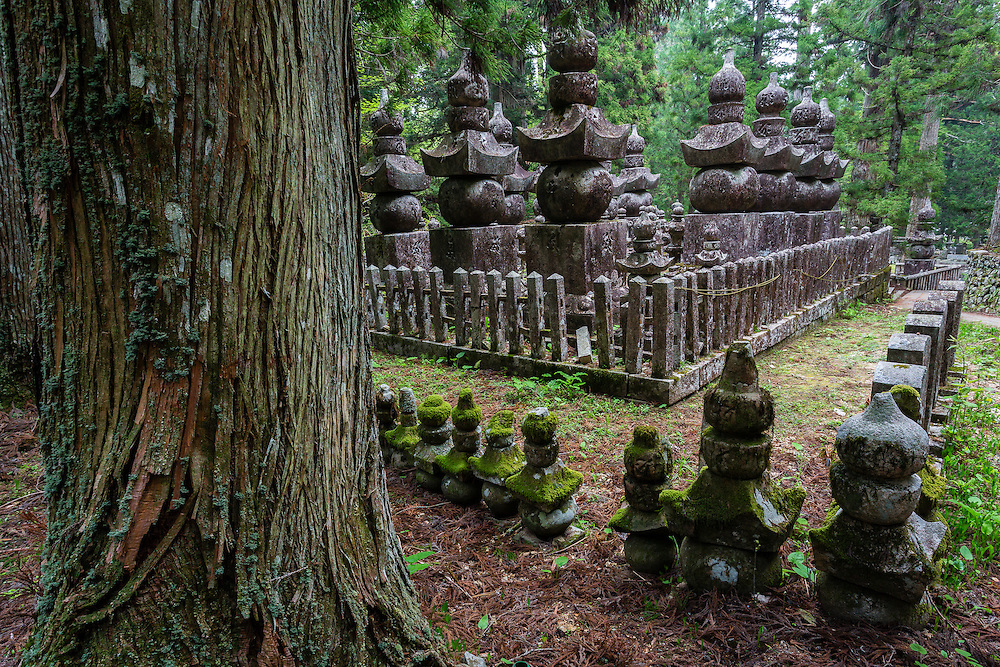 A row of buddhist tombstones in Okunoin cemetery, in Koyasan. The buddhist tombs have the representation of the five elements: earth, fire, air, water, and consciousness.