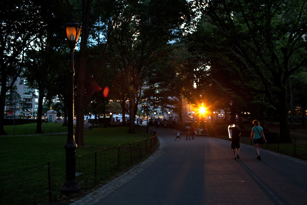 The sun sets in Central Park alongside Columbus Circle in New York on June 23, 2012.