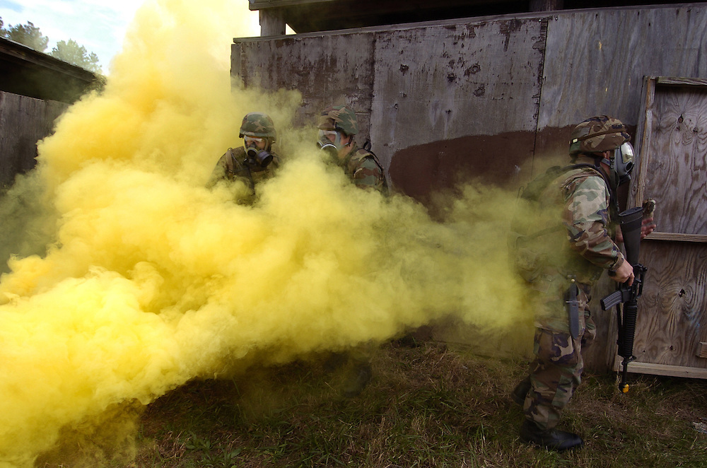 U. S. Navy combat photographers conduct military operations on urban terrain and close quarter combat during tactical integration field training.