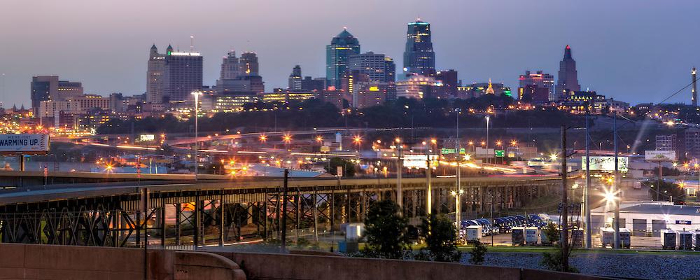 Sunrise panorama photo of downtown Kansas City Missouri skyline, taken from St. John's Park in Kansas City, Kansas across the state line.
