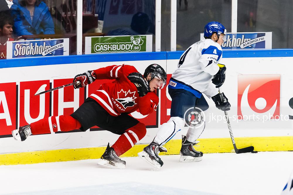 140104 Ishockey, JVM, Semifinal,  Kanada - Finland<br /> Icehockey, Junior World Cup, SF, Canada - Finland.<br /> Canadian player falls behind Mikko Lehtonen, (FIN).<br /> Kanadensisk spelare faller bakom Mikko Lehtonen, (FIN).<br /> Endast f&ouml;r redaktionellt bruk.<br /> Editorial use only.<br /> &copy; Daniel Malmberg/Jkpg sports photo