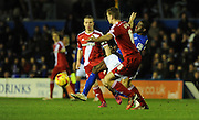 Demarai Gray is brought down by Ben Gibson during the Sky Bet Championship match between Birmingham City and Middlesbrough at St Andrews, Birmingham, England on 18 February 2015. Photo by Simon Kimber.