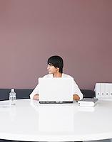 Man Using Laptop at White Table profile