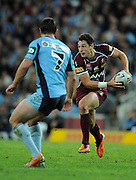 May 25th 2011: Billy Slater of the Maroons draws in Blues defender Mitchell Pearce during game 1 of the 2011 State of Origin series at Suncorp Stadium in Brisbane, Australia on May 25, 2011. Photo by Matt Roberts/mattrIMAGES.com.au / QRL