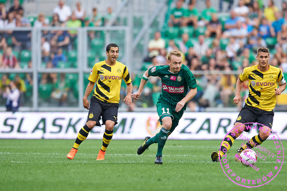 (C) Sebastian Mila of Slask Wroclaw controls the ball during international friendly soccer match between WKS Slask Wroclaw and BVB Borussia Dortmund on Municipal Stadium in Wroclaw, Poland.<br /> <br /> Poland, Wroclaw, August 6, 2014<br /> <br /> Picture also available in RAW (NEF) or TIFF format on special request.<br /> <br /> For editorial use only. Any commercial or promotional use requires permission.<br /> <br /> Mandatory credit:<br /> Photo by &copy; Adam Nurkiewicz / Mediasport