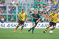 (C) Sebastian Mila of Slask Wroclaw controls the ball during international friendly soccer match between WKS Slask Wroclaw and BVB Borussia Dortmund on Municipal Stadium in Wroclaw, Poland.<br /> <br /> Poland, Wroclaw, August 6, 2014<br /> <br /> Picture also available in RAW (NEF) or TIFF format on special request.<br /> <br /> For editorial use only. Any commercial or promotional use requires permission.<br /> <br /> Mandatory credit:<br /> Photo by © Adam Nurkiewicz / Mediasport