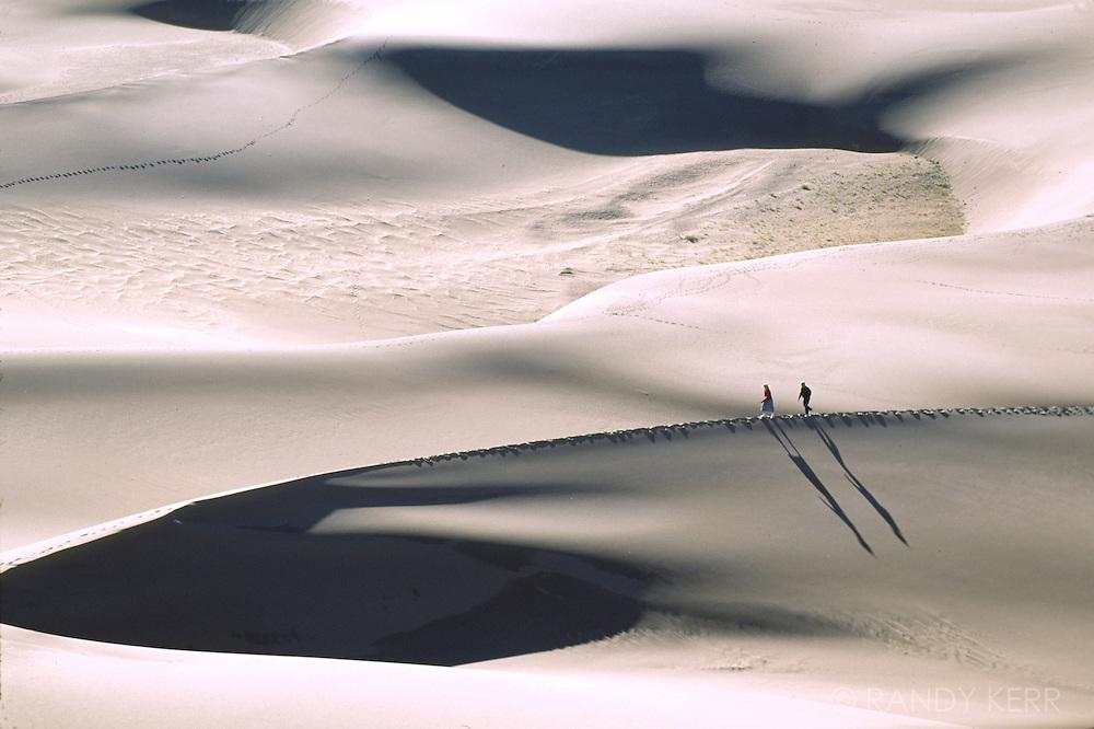 Hikers on sand dunes