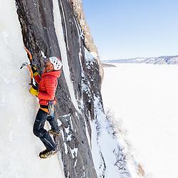 Jeff Mercier climbing Capteur de Reve on Lake Walker, near Port-Cartier, Quebec, Canada