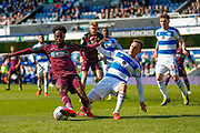 Swansea City midfielder Nathan Dyer (12) battles for possession with Queens Park Rangers midfielder Josh Scowen (11) during the EFL Sky Bet Championship match between Queens Park Rangers and Swansea City at the Loftus Road Stadium, London, England on 13 April 2019.