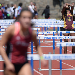 Staff photos by Tom Kelly IV<br /> Central's Taylor Dallas who was the top seed going into the girls AAA 110m hurdles fell half way down the track and showed her frustration when she stood up during the District 12 track and field championships in Philadelphia, Thursday afternoon.
