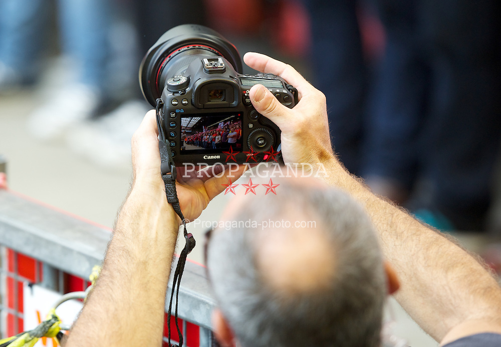 LIVERPOOL, ENGLAND - Sunday, August 26, 2012: A member of the Fox documentary crew films the Spion Kop with a Canon EOS 5D camera during the Premiership match against Manchester City at Anfield. (Pic by David Rawcliffe/Propaganda)
