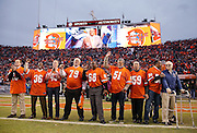 "Sports analyst Tom Jackson is shown on the Sports Authority Field at Mile High stadium scoreboard while addressing fellow members (including L-R Randy Gradishar, Billy Thompson, Steve Foley, Rubin Carter, Barney Chavous, Bob Swenson, Joe Rizzo, Larry Evans, and head coach Red Miller) of the 1977 Denver Broncos defense nicknamed ""Orange Crush"" as they are honored at halftime during the Denver Broncos NFL week 19 AFC Divisional Playoff football game against the Indianapolis Colts on Sunday, Jan. 11, 2015 in Denver. The Colts won the game 24-13. ©Paul Anthony Spinelli"