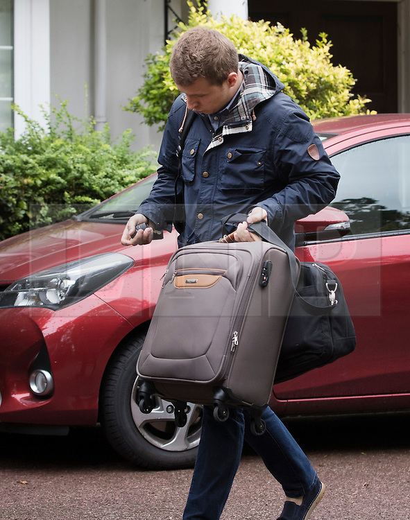 © Licensed to London News Pictures. 04509/2016. London, UK. An aide is seen carrying bags before Keith Vaz MP leaves  his north London home.  A Sunday newspaper has printed allegations that Mr Vaz met with male prostitutes at his flat.  He has stood down from the chairmanship of the Home Affairs Select Committee. Photo credit: Peter Macdiarmid/LNP
