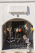 A few flowers and note attached to the gate at the historic Mother Emanuel African Methodist Episcopal Church October 21, 2015 in Charleston, South Carolina. The church was the site of the mass shooting that killed nine-people in June 2015.