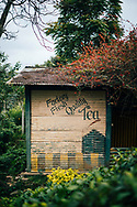 A sign for quality tea on the side of a shed, Ella, Sri Lanka, Asia