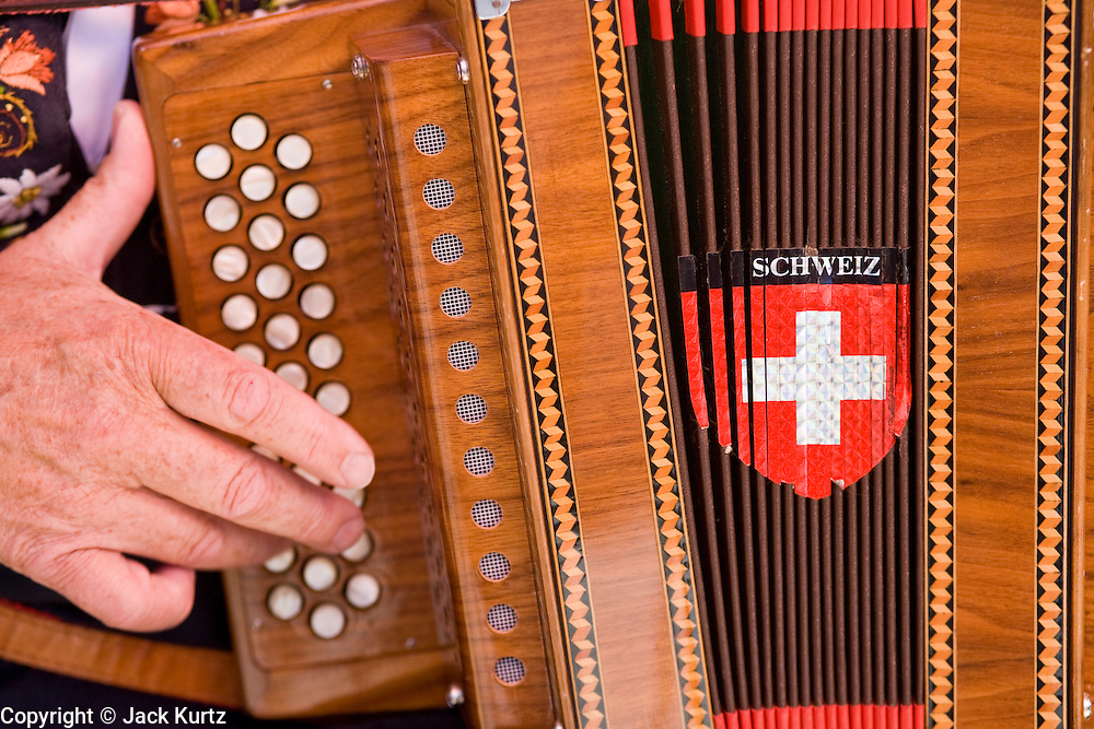 01 AUGUST 2007 -- INTERLAKEN, BERN, SWITZERLAND: An accordion player performs during Swiss National Day celebrations in Interlaken, in the canton of Bern, Switzerland. Swiss National Day is the Swiss national holiday and celebrates the founding of the Swiss confederation 716 years ago, in 1291. There are parades, fireworks shows and bonfires throughout the country.  Photo by Jack Kurtz