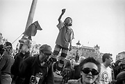 Man in gas mask dancing on plinth, Reclaim the Streets, Trafalgar Square, London, May 1997