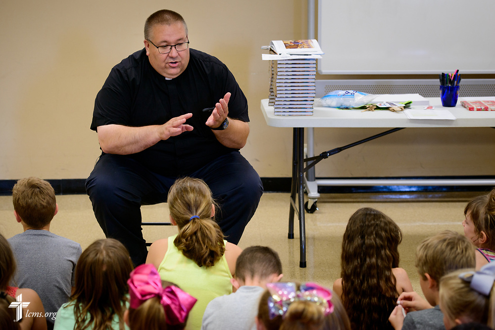 The Rev. David Daniels, pastor of Zion Lutheran Church, Ottawa, Ill., leads a Bible story for campers of Camp Courage VBS at the church on Thursday, July 13, 2017, in Ottawa. LCMS Communications/Erik M. Lunsford