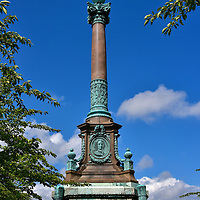 Ivar Huitfeldt Column in Copenhagen, Denmark<br /> This monument is a tribute to Ivar Huitfeldt and 600 of his men who died heroically in 1704 during a Great Northern War sea battle against Sweden.  A relief medallion of the Danish Fleet Commander can be seen at the base of the column which is flanked by four canons.  The tribute was created by Vilhelm Dahlerup in 1886.  It is located in the Langeline park along an esplanade that is parallel to the port.